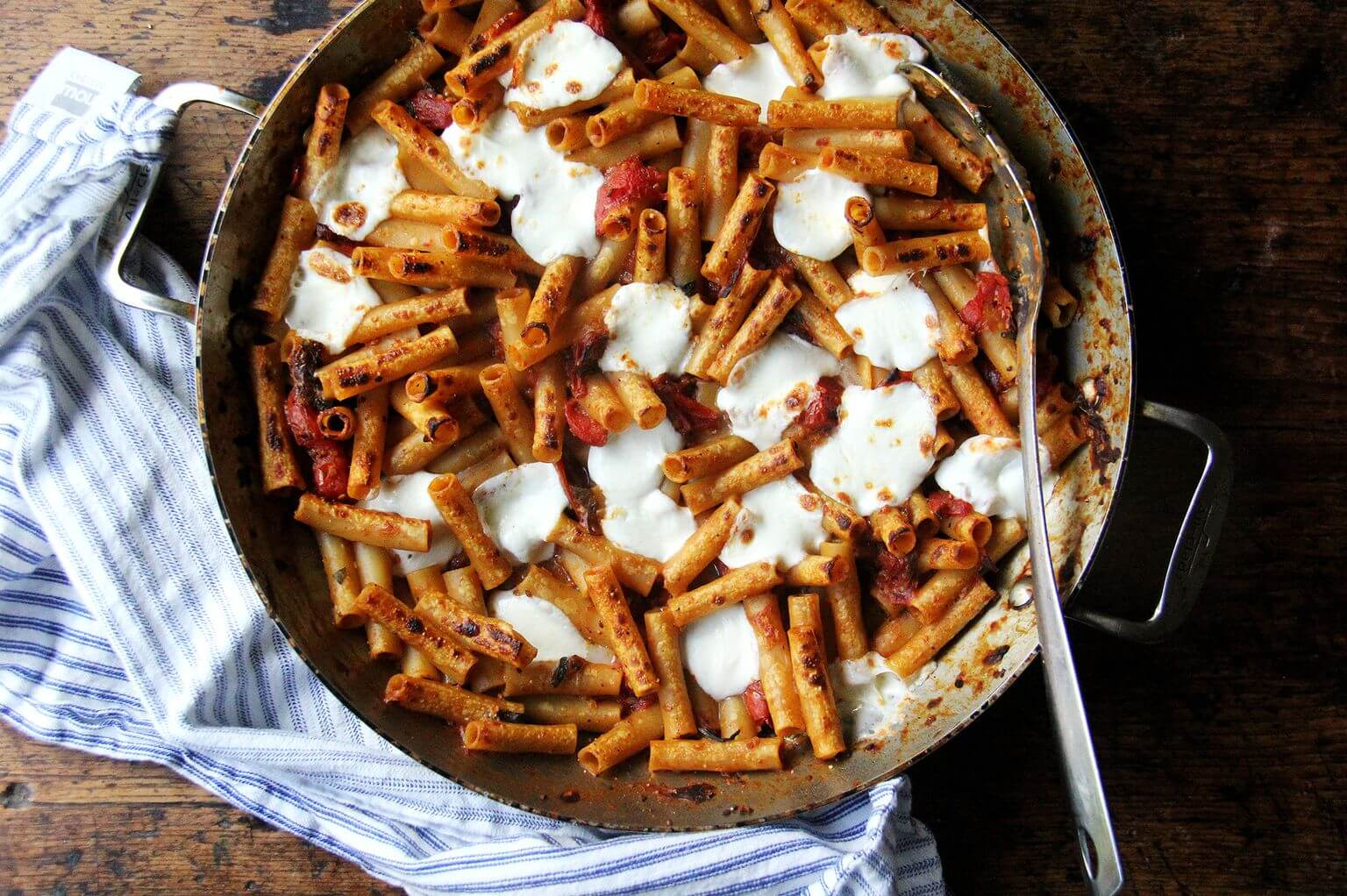 A large skillet of one-pan baked ziti.