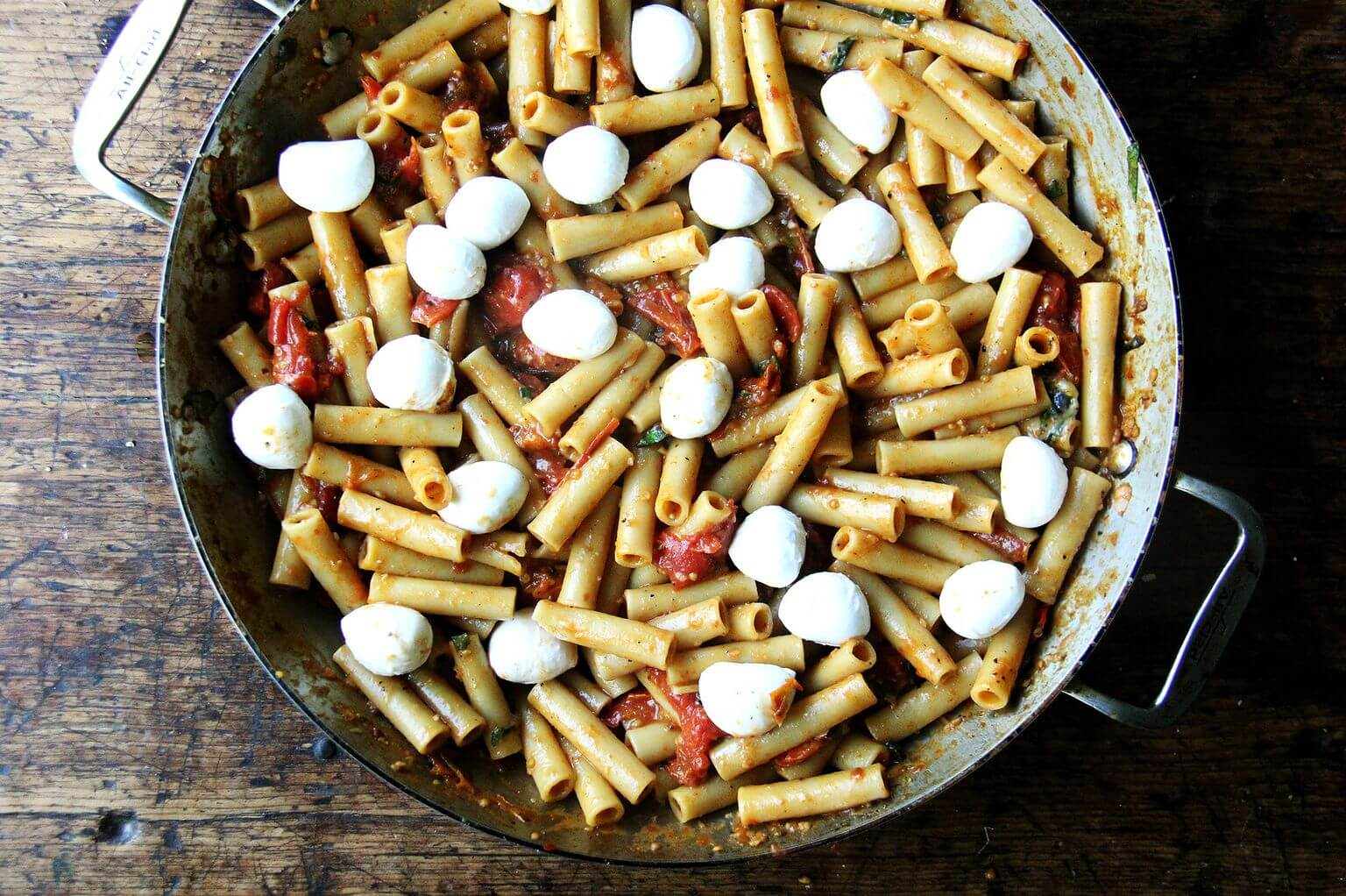 A large skillet of one-pan baked ziti topped with mozzarella.