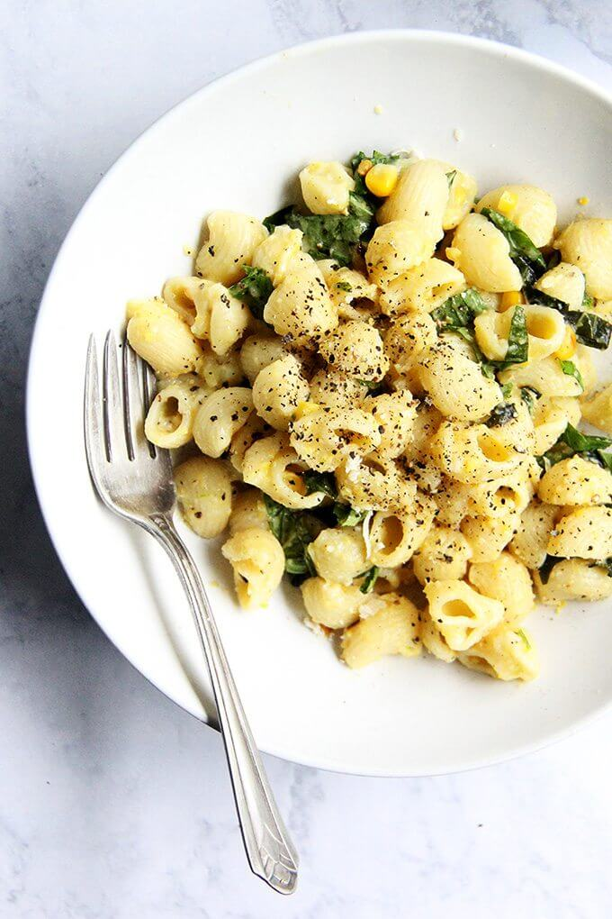 This creamy corn pasta has since become one of my favorite summer meals, and it's simple, too: strip two ears of corn, sauté the kernels in butter with scallions, purée the mixture into a sauce, then toss it with pasta, fresh lemon, basil, parmesan, and chili flakes. If you make one thing this weekend let it be this pasta. // alexandracooks.com