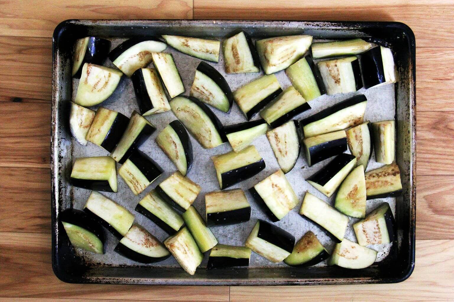 Chopped eggplant on a sheet pan
