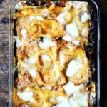 A pan of roasted eggplant and Swiss chard lasagna.
