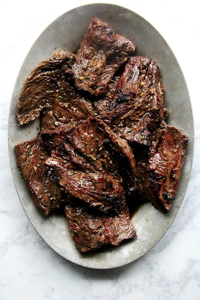 A platter of grilled hanger steak.