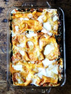 This roasted eggplant lasagna with sautéed greens uses tomato sauce layered between noodles, roasted eggplant rounds, sautéed Swiss chard, and a mix of parmesan and mozzarella. I've omitted the classic ricotta + egg layer here because I've never loved it, but feel free to add it. This is a recipe that can be tailored to your liking. // alexandracooks.com
