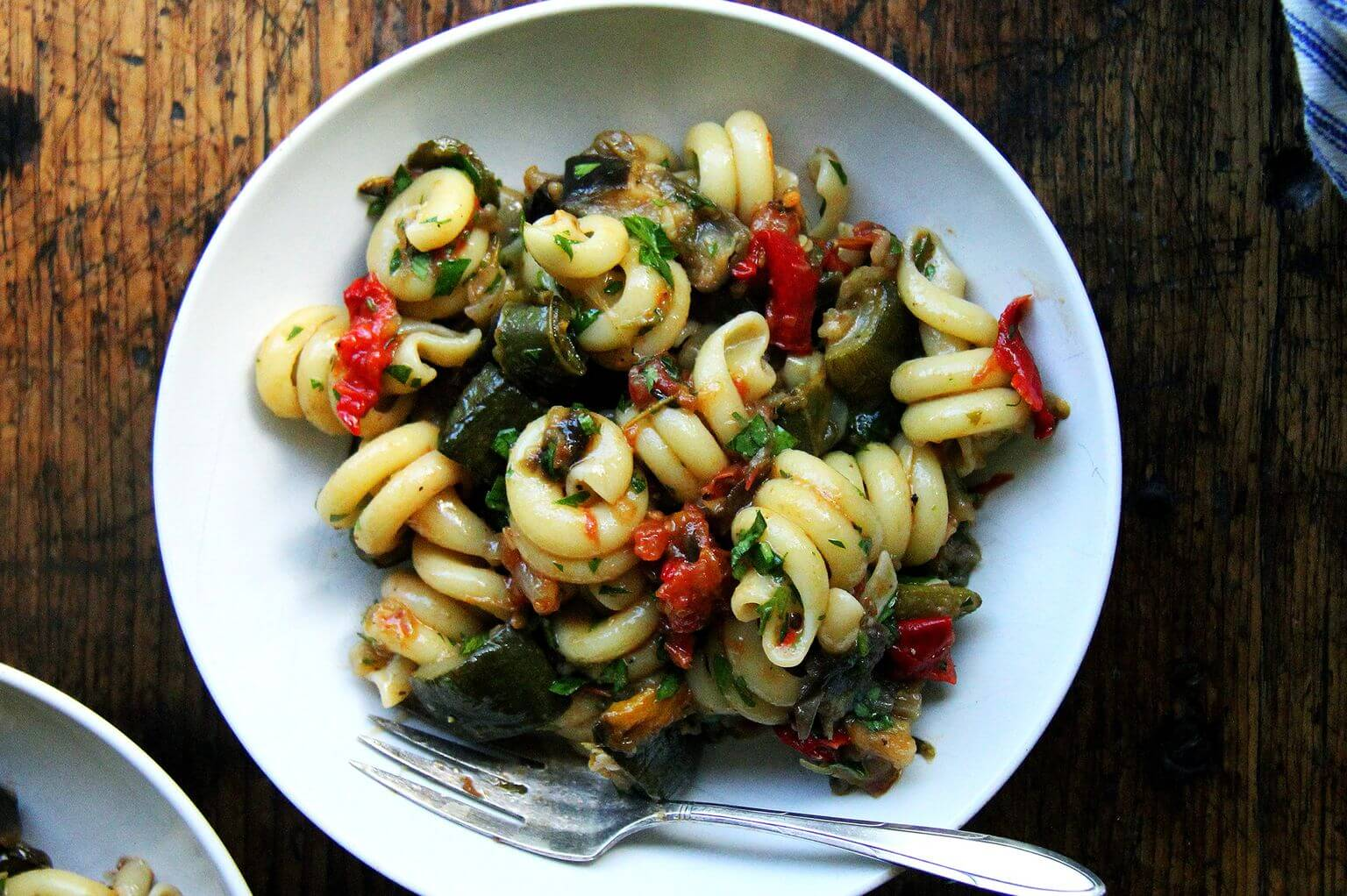 A bowl of roasted ratatouille pasta.