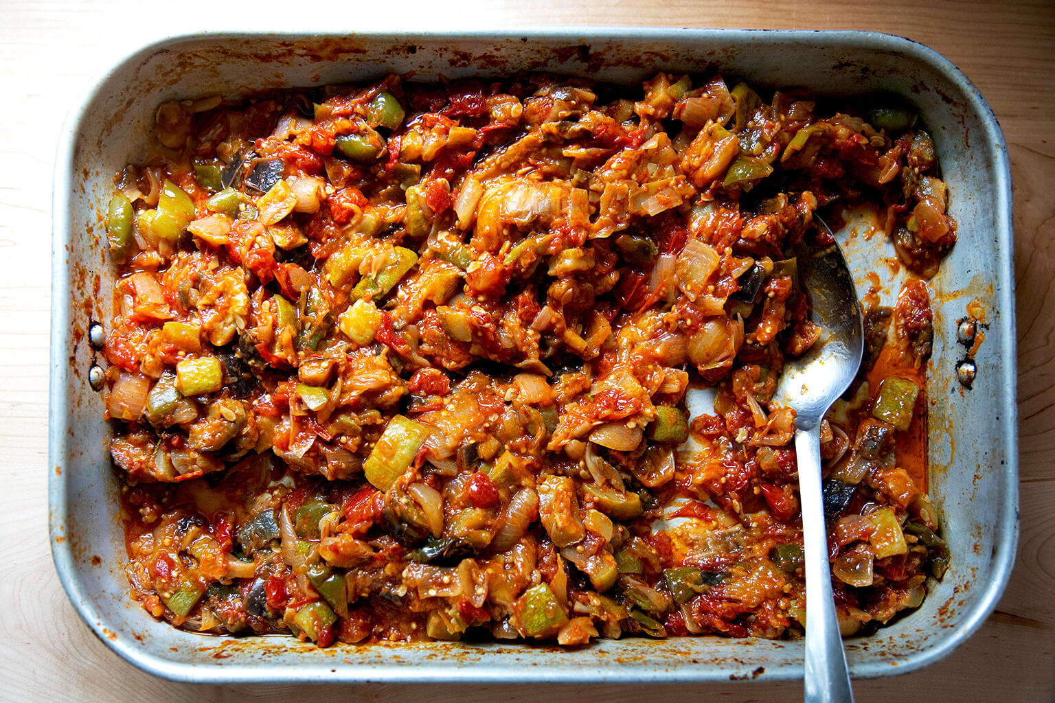 A roasting pan with roasted ratatouille