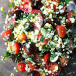raw corn salad with tomatoes, basil, feta and lime