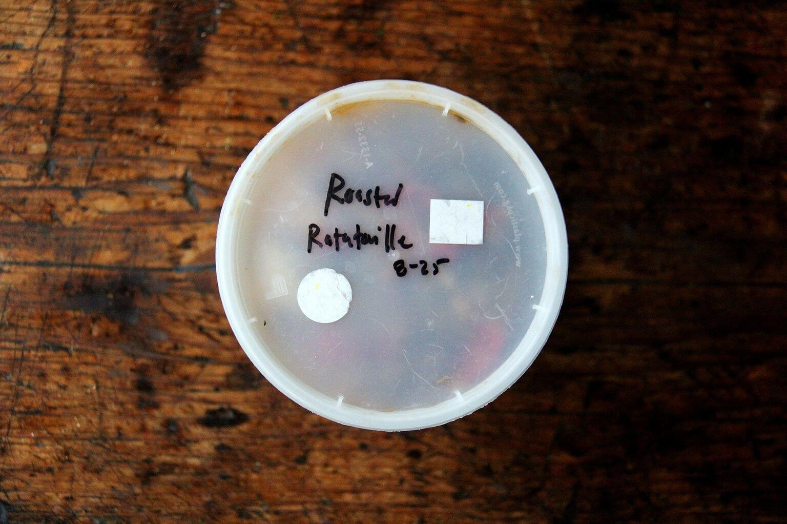 A quart container packed with roasted ratatouille.