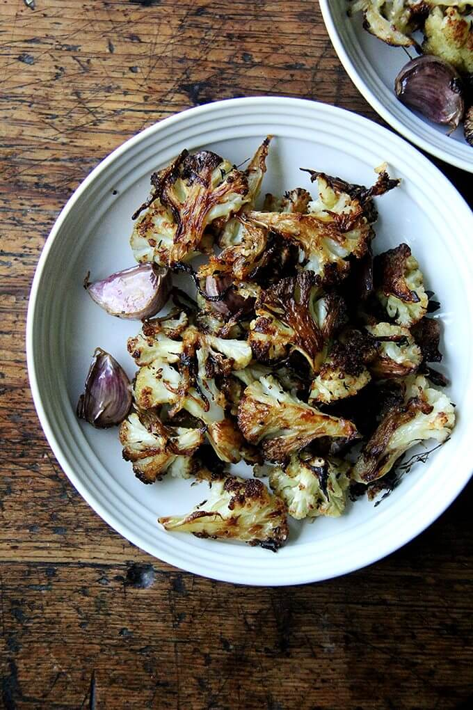A plate of oven-roasted cauliflower with garlic and parmesan.
