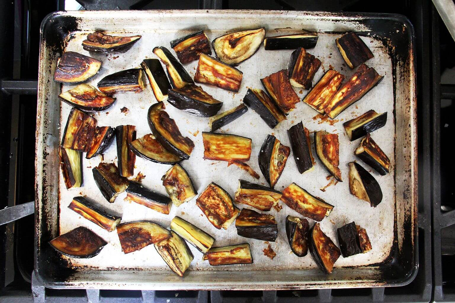 A sheet pan of roasted eggplant.