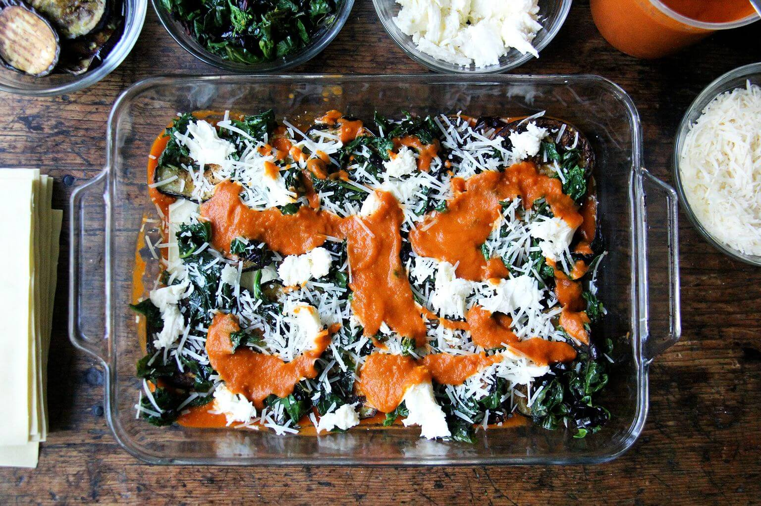 A layer of sauce in roasted eggplant Swiss chard lasagna