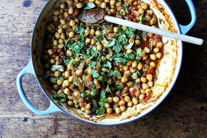 Chickpea tagine in a Le Creuset braiser sprinkled with cilantro.