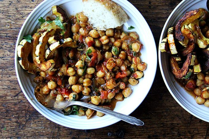 A bowl of chickpea tagine with roasted delicata squash.