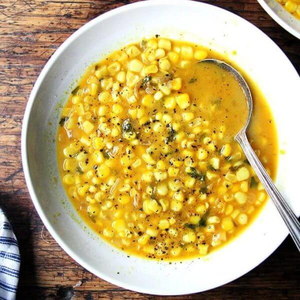 A bowl of curried coconut corn soup.