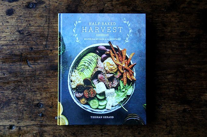 The half baked harvest cookbook on a table.