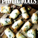 Salami and provolone phyllo rolls on a board.