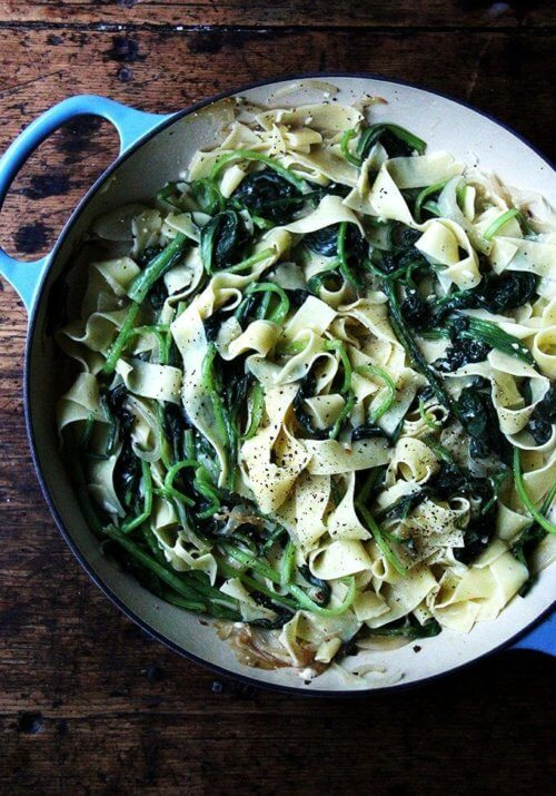 I love the addition of bacon found in classic carbonara recipes but it's not missed in this no-bacon pasta carbonara. And though the heap of greens wilts down to seemingly nothing, I know it's there, doing all the good things a heap of greens ought to be doing. // alexandracooks.com