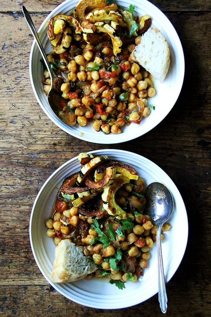 Two bowls of chickpea tagine with roasted delicata squash.