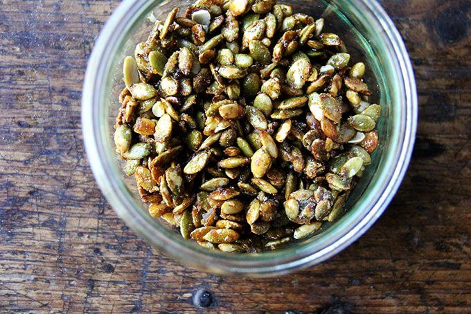 A jar of candied pumpkin seeds.