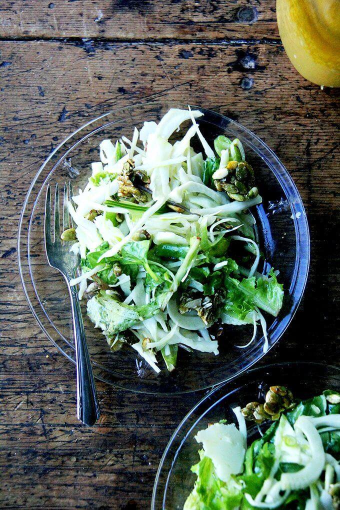A fall salad on a plate.