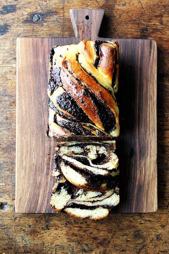 A cut loaf of orange-chocolate babka.