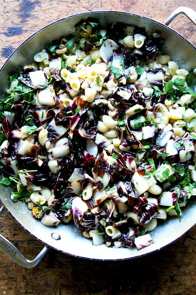 In less than 10 minutes, this radicchio pasta enters the pan, the silky sauce enveloping it along with the walnuts, parsley, and orange zest. Lots of fresh cracked pepper and shavings of Pecorino at the table completed the dish. // alexandracooks.com