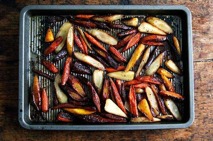 Twice-roasted carrots on a sheet pan.