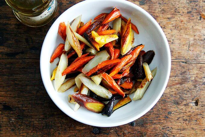 Sliced roasted carrots dressed in vinegar.