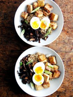A bowl of brown rice, crispy tofu and mushrooms, and perfect instant pot soft-boiled eggs.