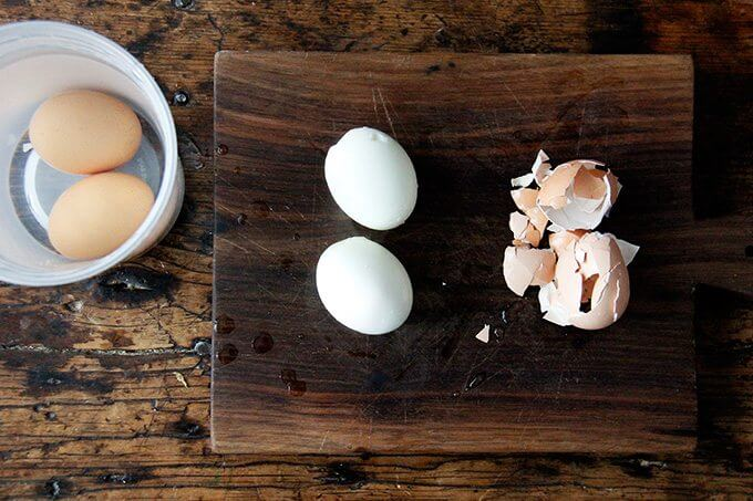 Two instant post soft-boiled eggs, freshly peeled.