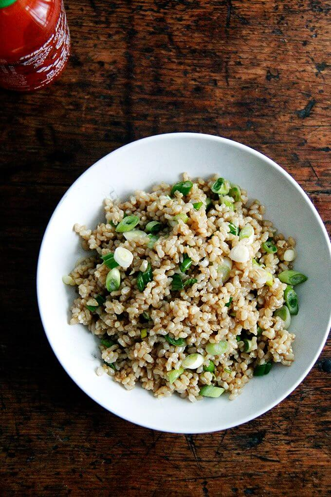 A bowl of perfectly cooked and seasoned Instant Pot brown rice.