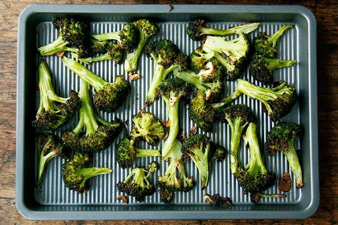 A sheet pan of roasted broccoli.