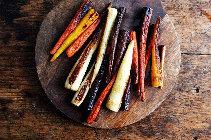 Roasted carrots on a board.