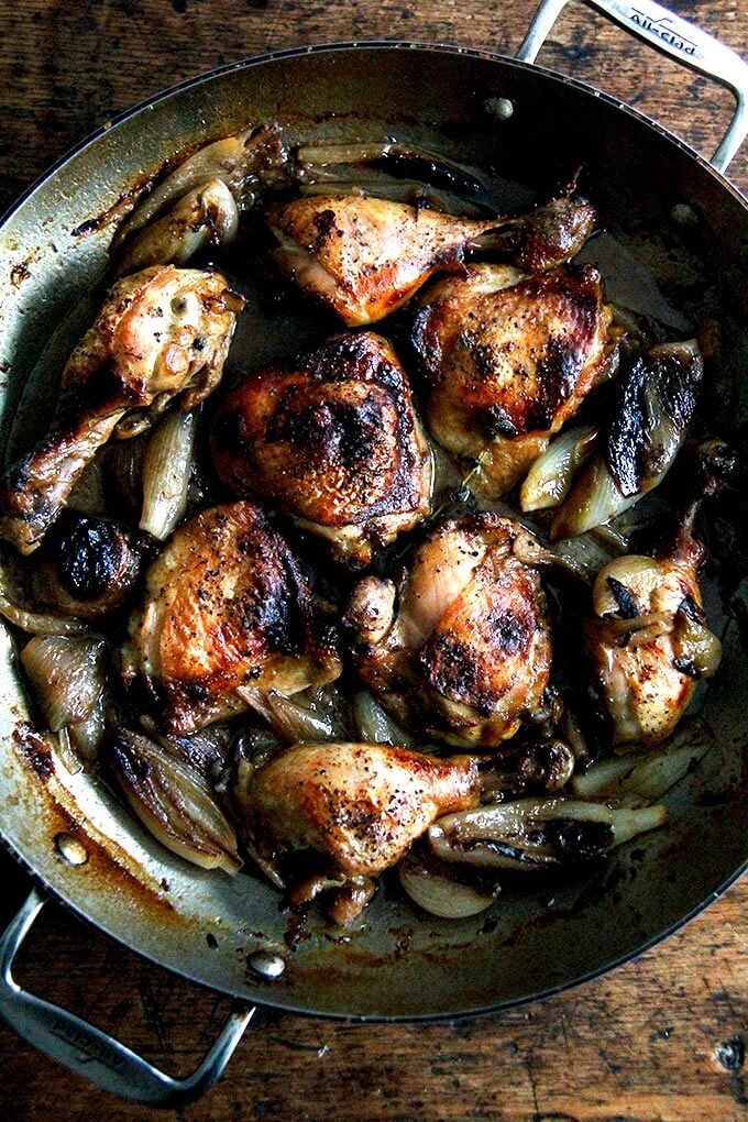 A pan of roast chicken and shallots.