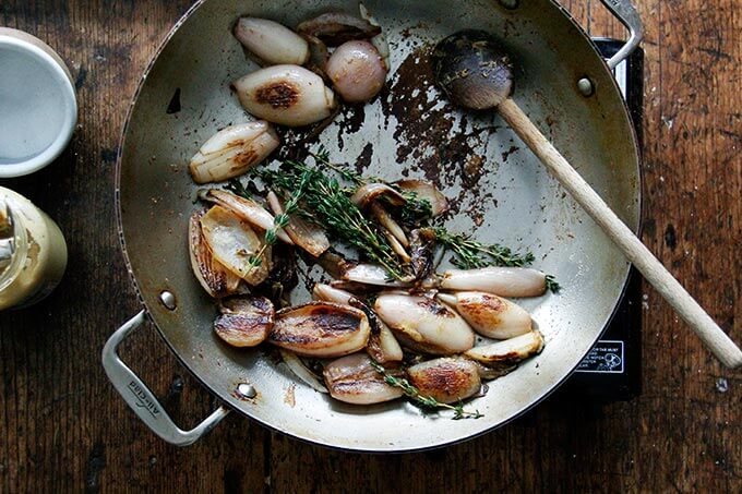 A skillet with browned shallots.