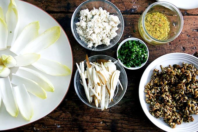 All of the components for the endive boats on a table.
