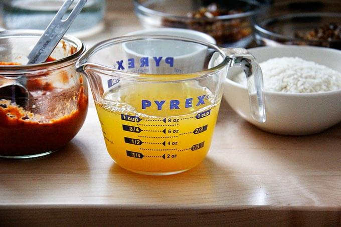 A liquid measure with fresh orange juice and water.