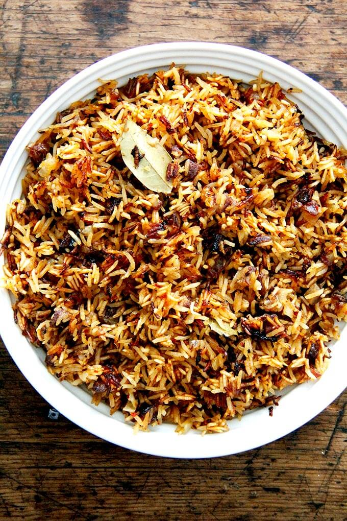A bowl of Moroccan Rice with dates and orange.