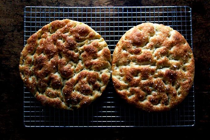 Overnight, refrigerator focaccia bread, resting on a cooling rack.