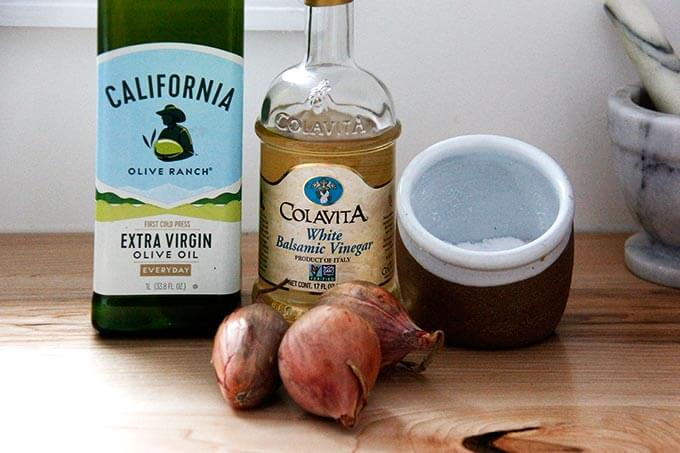Ingredients for shallot vinaigrette: olive oil, white balsamic, shallots, and salt.