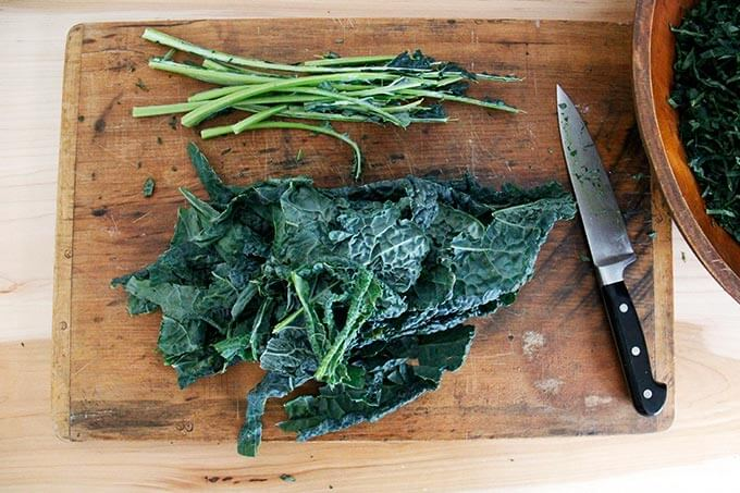Removing the kale leaves from the stems.