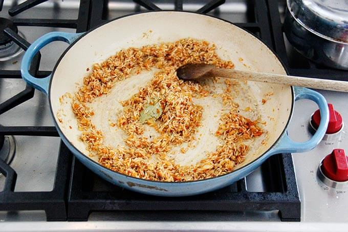 A skillet with Moroccan rice in the making.