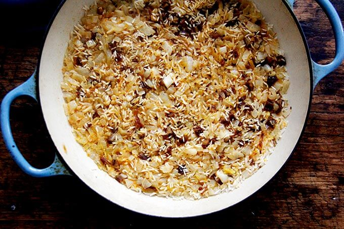 Just-cooked Moroccan rice in a skillet on the stovetop.