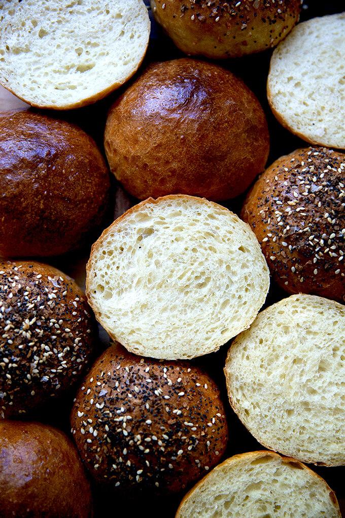 Halved Brioche buns on a board.