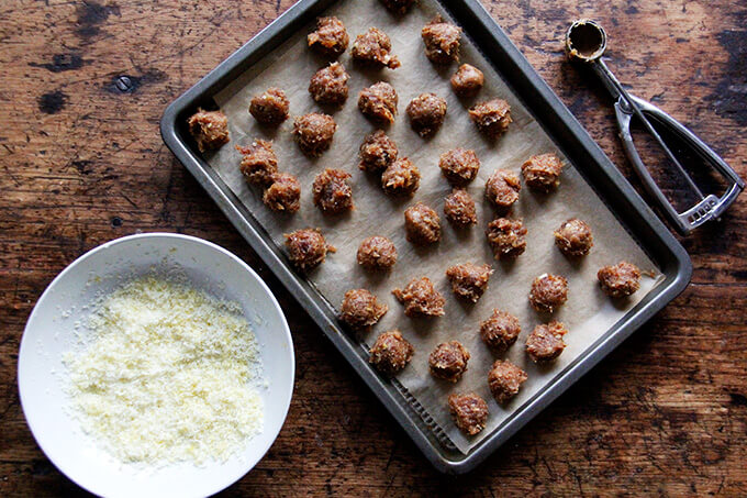 Lemon coconut date balls on a sheet pan.
