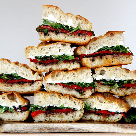 Slab Sandwich with Olive Tapenade, Whipped Honey Goat Cheese, and Roasted Red Peppers