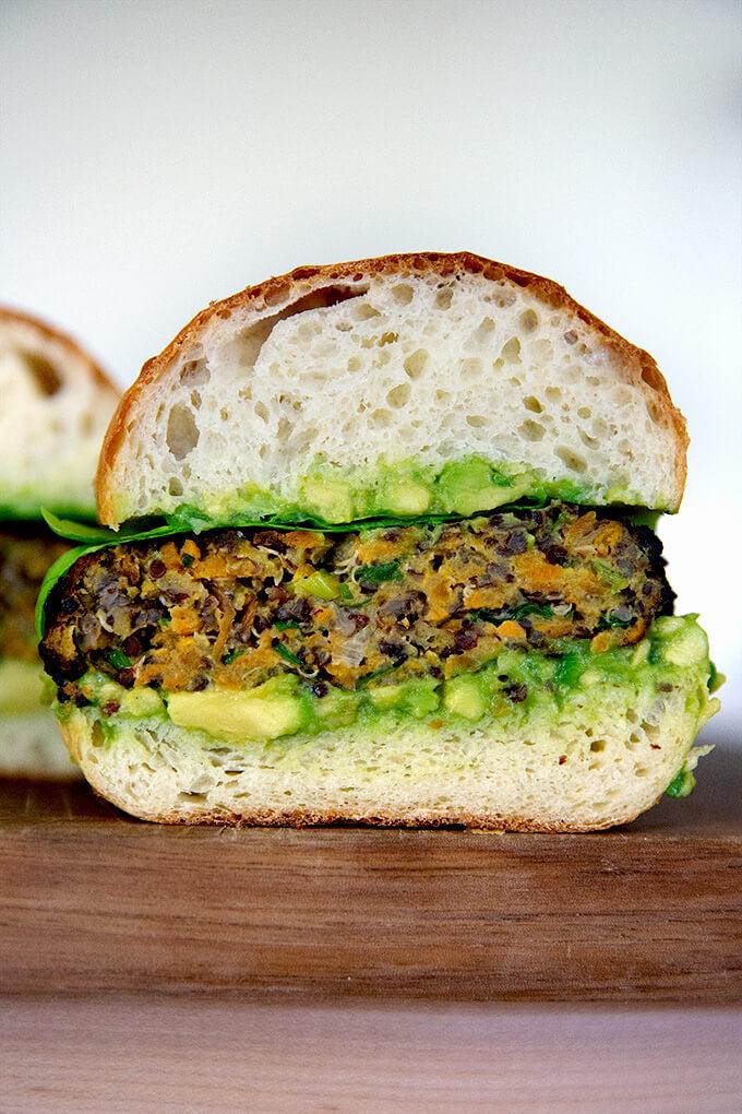 Halved Sweet potato and quinoa veggie burger.