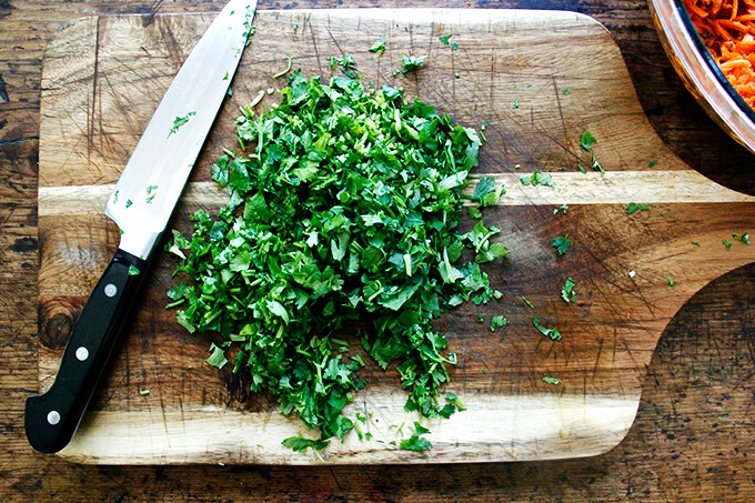 A board with minced cilantro on top.