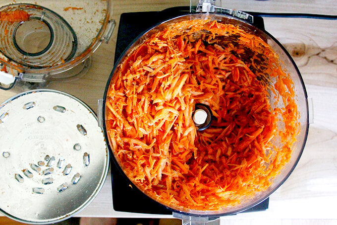 Grated carrots in a food processor.