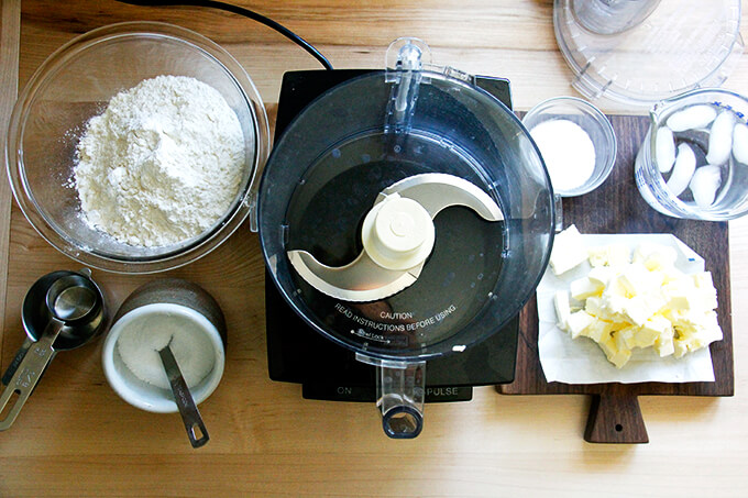 A counter with a food processor and the ingredients to make foolproof food processor pastry dough.