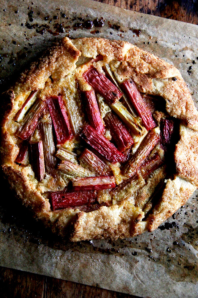 Just baked rhubarb-frangipane galette on sheet pan with parchment paper underneath.